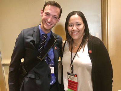 Joshua Bauml, MD, and Cardinale Smith, MD, PhD, catch up during the reception.