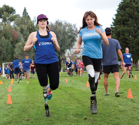 Jami Goldman-Marseilles, right, trains at an Össur Mobility Clinic with Paralympian Nicole Roundy.