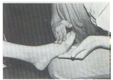 The feet are soaked in warm tap water, blotted dry with a towel, and massaged with mineral oil.