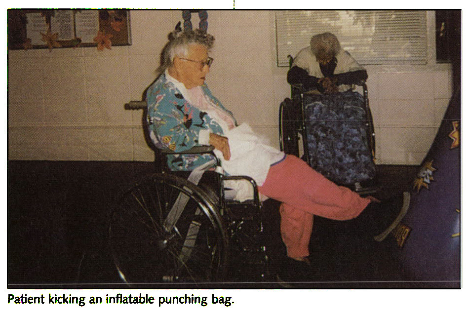 Patient kicking an inflatable punching bag.