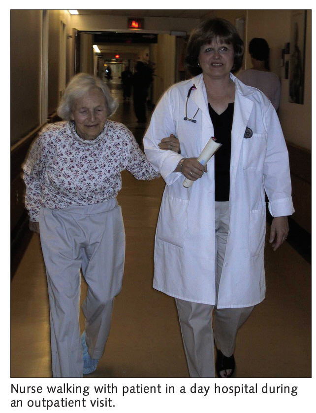 Nurse walking with patient in a day hospital during an outpatient visit.