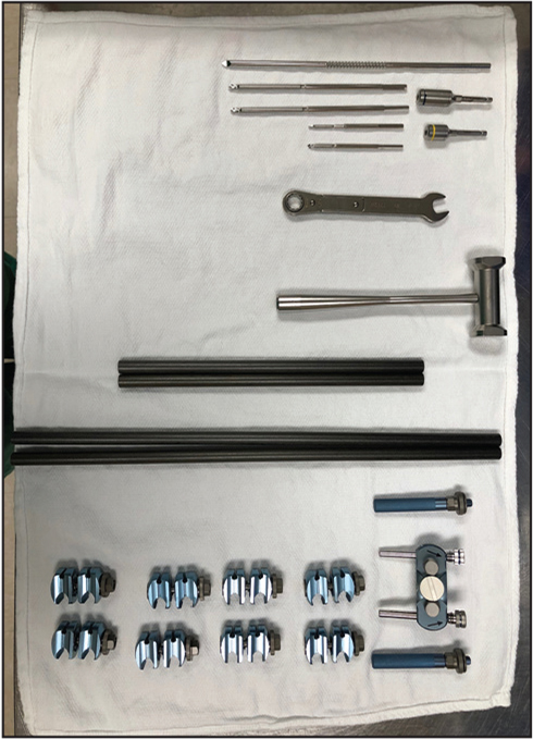 Prepared Mayo stand with two 5-mm half-pins, one 5-mm calcaneal transfixion pin, one 4-mm half-pin, one 3-mm half-pin, four bars with lengths to be determined, one multi-pin clamp, two outrigger posts, four pin-to-bar clamps, four bar-to-bar clamps, and appropriate wrenches.