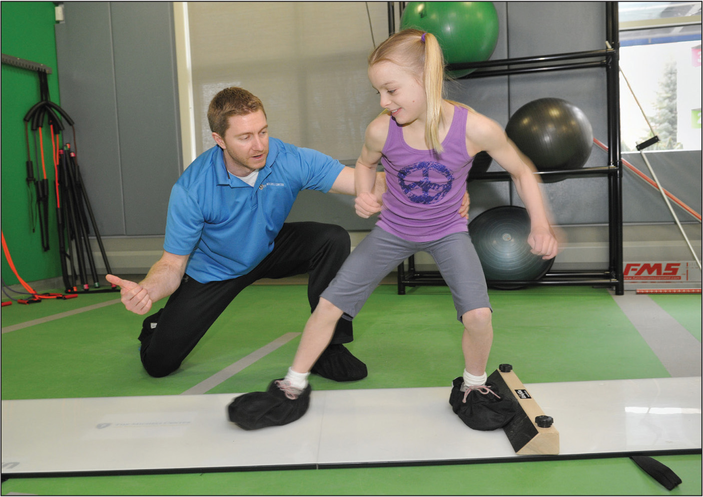 Training targeting improving hip muscle strength by using a slide board. From The Micheli Center for Sports Injury Prevention (Waltham, MA) with consent of both participants.