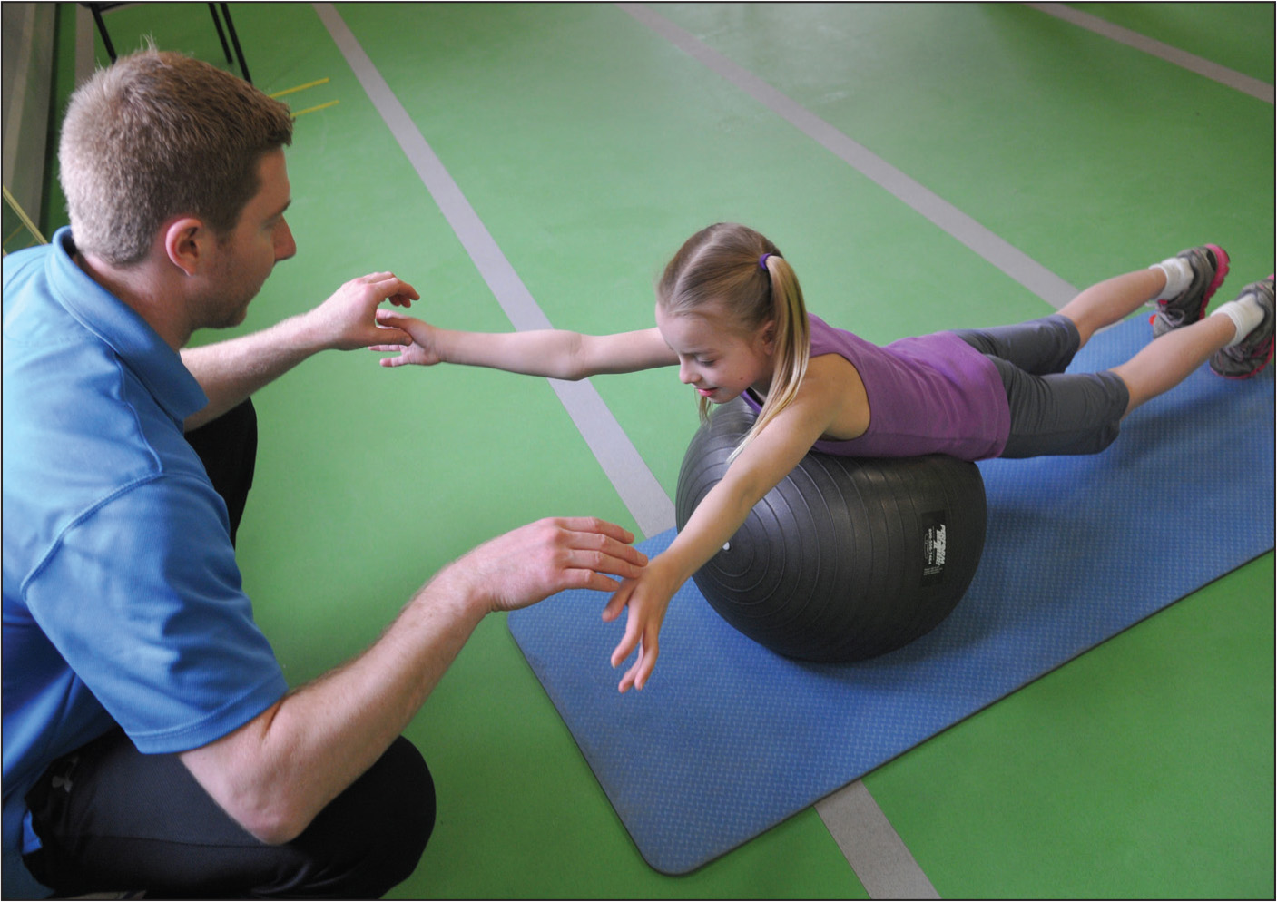 Training for peri scapular and upper trunk muscles, and core muscle strength and stabilization. From The Micheli Center for Sports Injury Prevention (Waltham, MA) with consent of both participants.