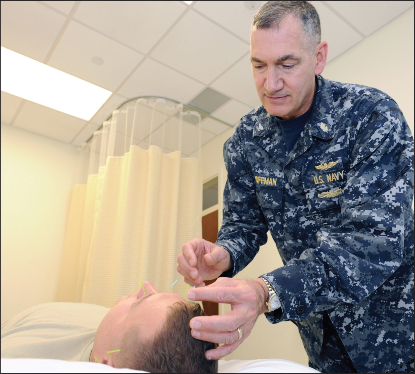 Robert L. Koffman, MD, MPH, inserting acupuncture needles into a soldier at the National Intrepid Center of Excellence in Bethesda, Maryland.Image courtesy of National Intrepid Center of Excellence.