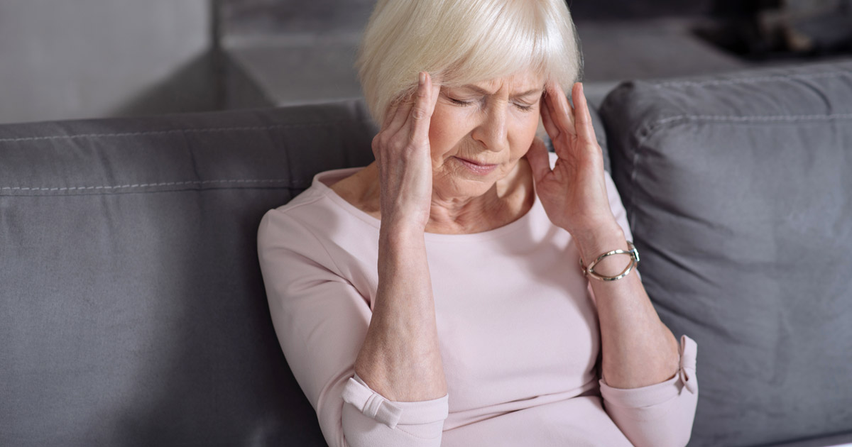 Gray haired woman with headache 2