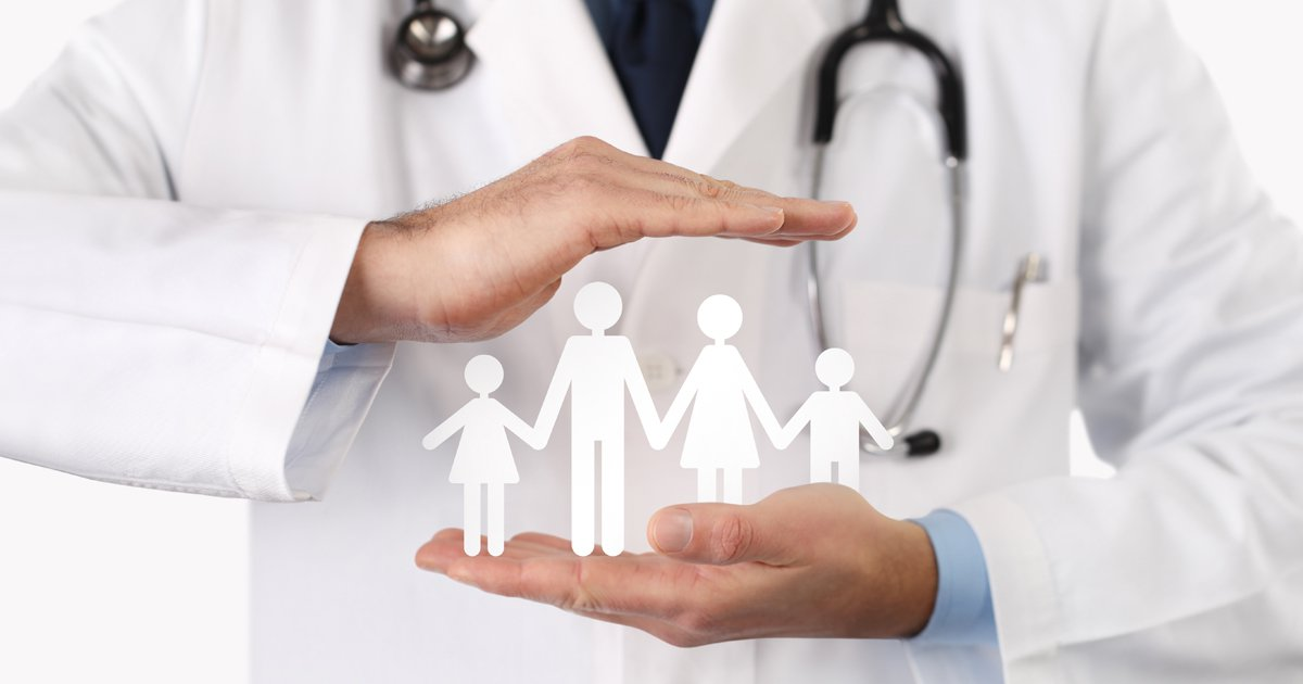 Doctor holding paper cut outs of family members