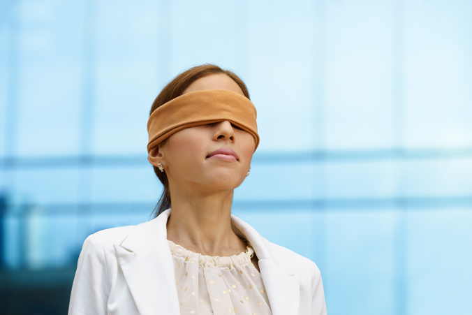 Photo of a blindfolded doctor