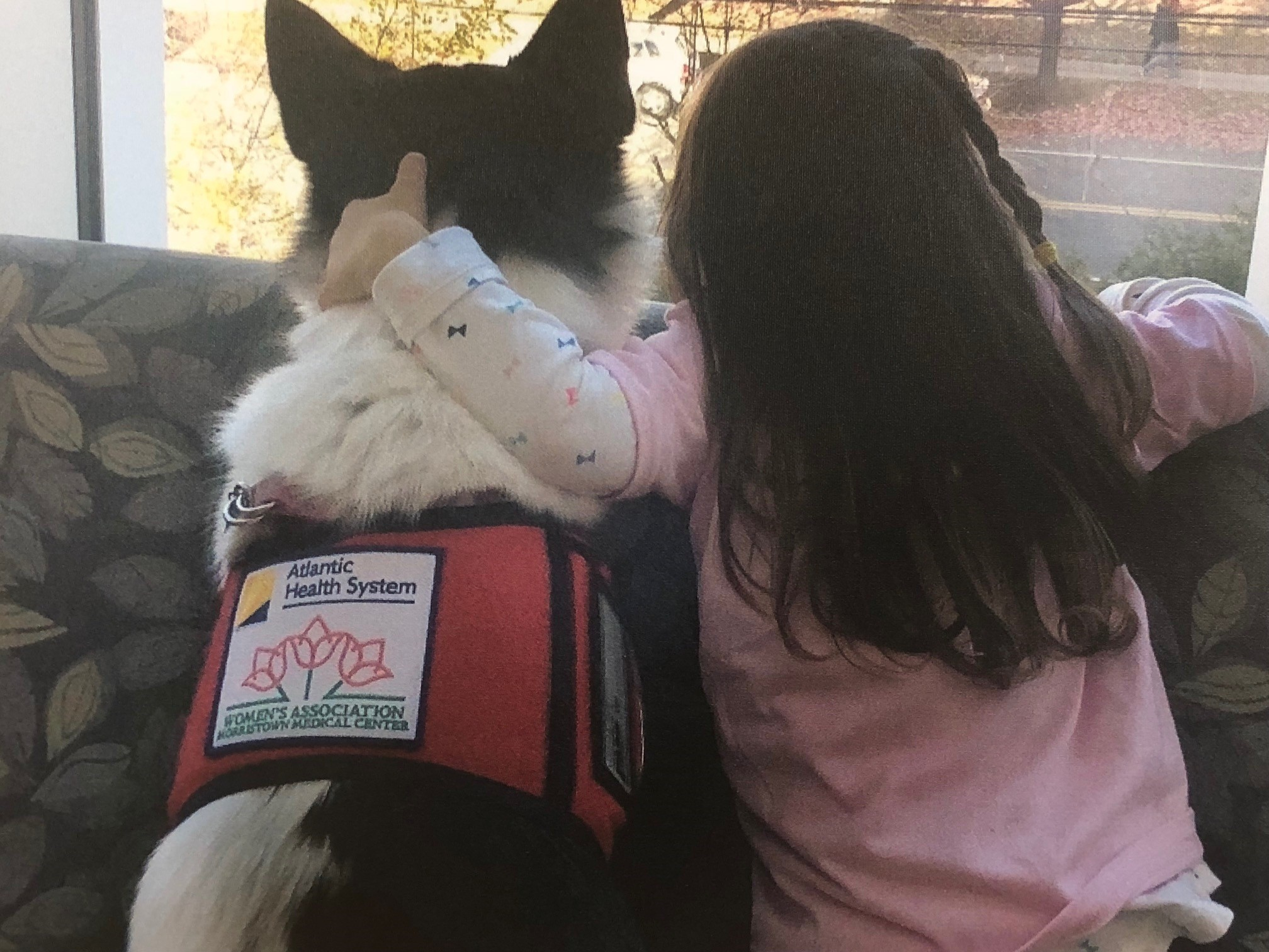 Photo of girl with therapy dog